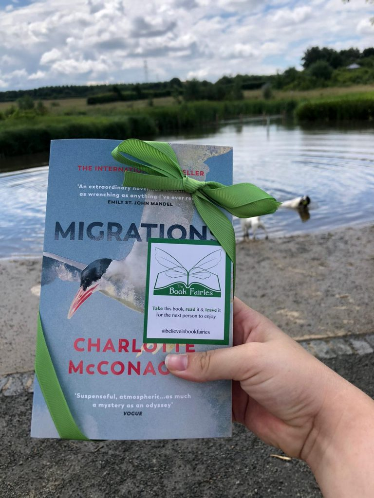 Book Fairies share copies of Migrations by Charlotte McConaghy published by Vintage Books beside some swans