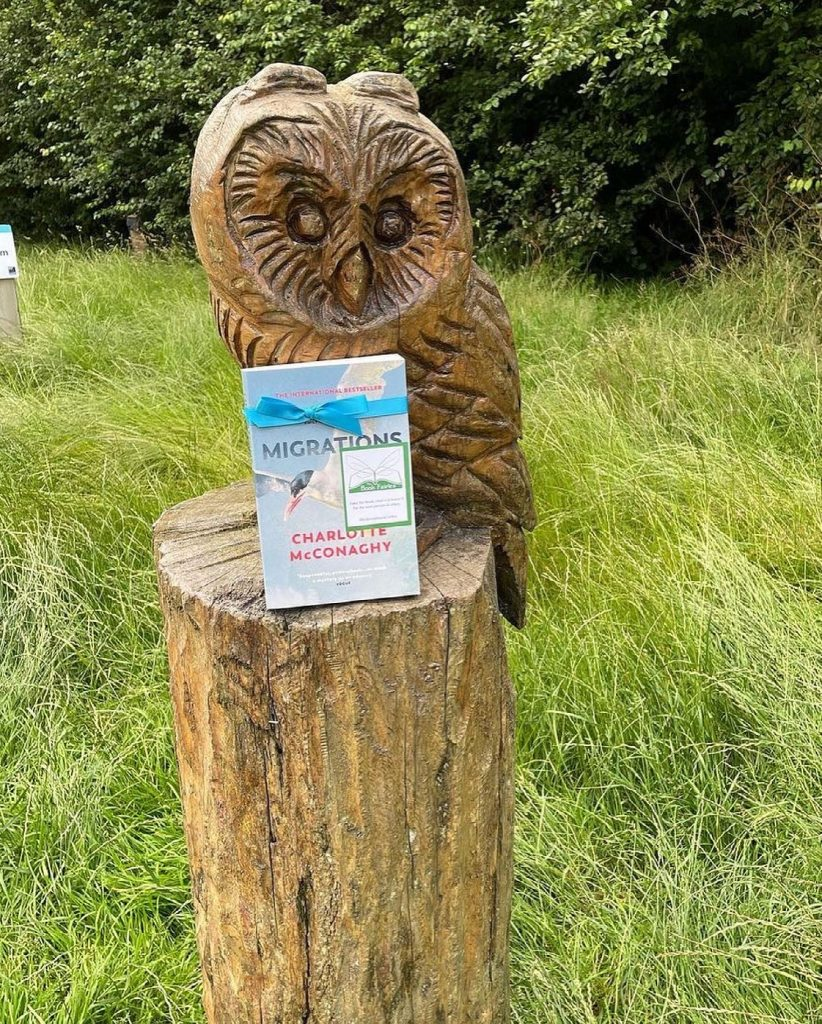 Book Fairies share copies of Migrations by Charlotte McConaghy published by Vintage Books at an owl statue