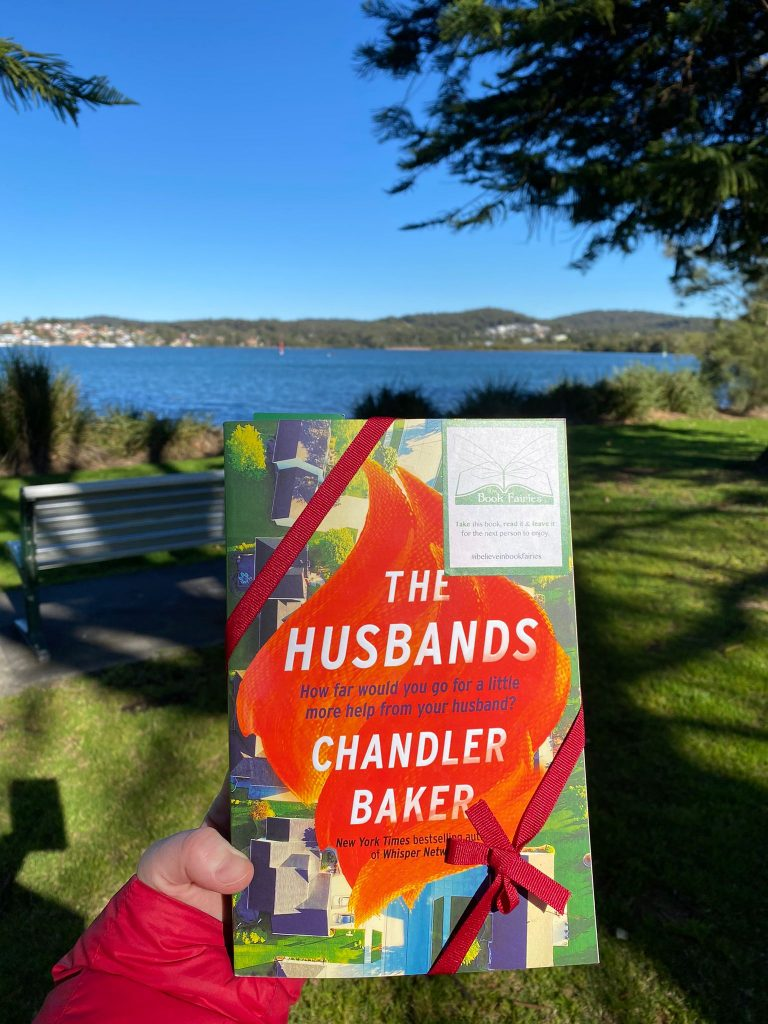 Book Fairies in Australia shared copies of The Husbands by Chandler Baker by a park