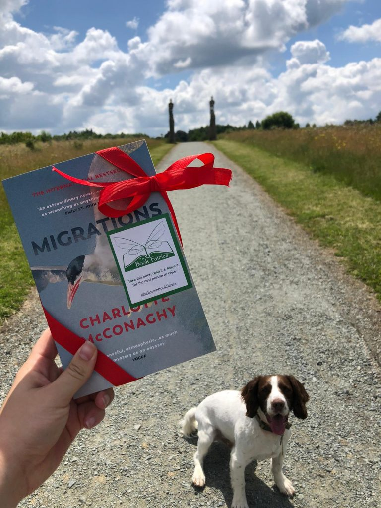 Book Fairies share copies of Migrations by Charlotte McConaghy published by Vintage Books with a dog