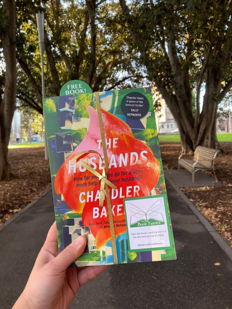 Book Fairies in Australia shared copies of The Husbands by Chandler Baker in a park
