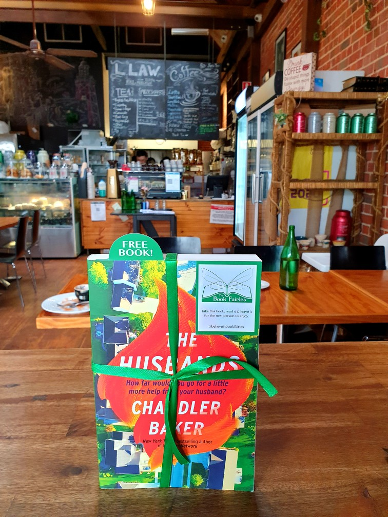 Book Fairies in Australia shared copies of The Husbands by Chandler Baker - in a cafe