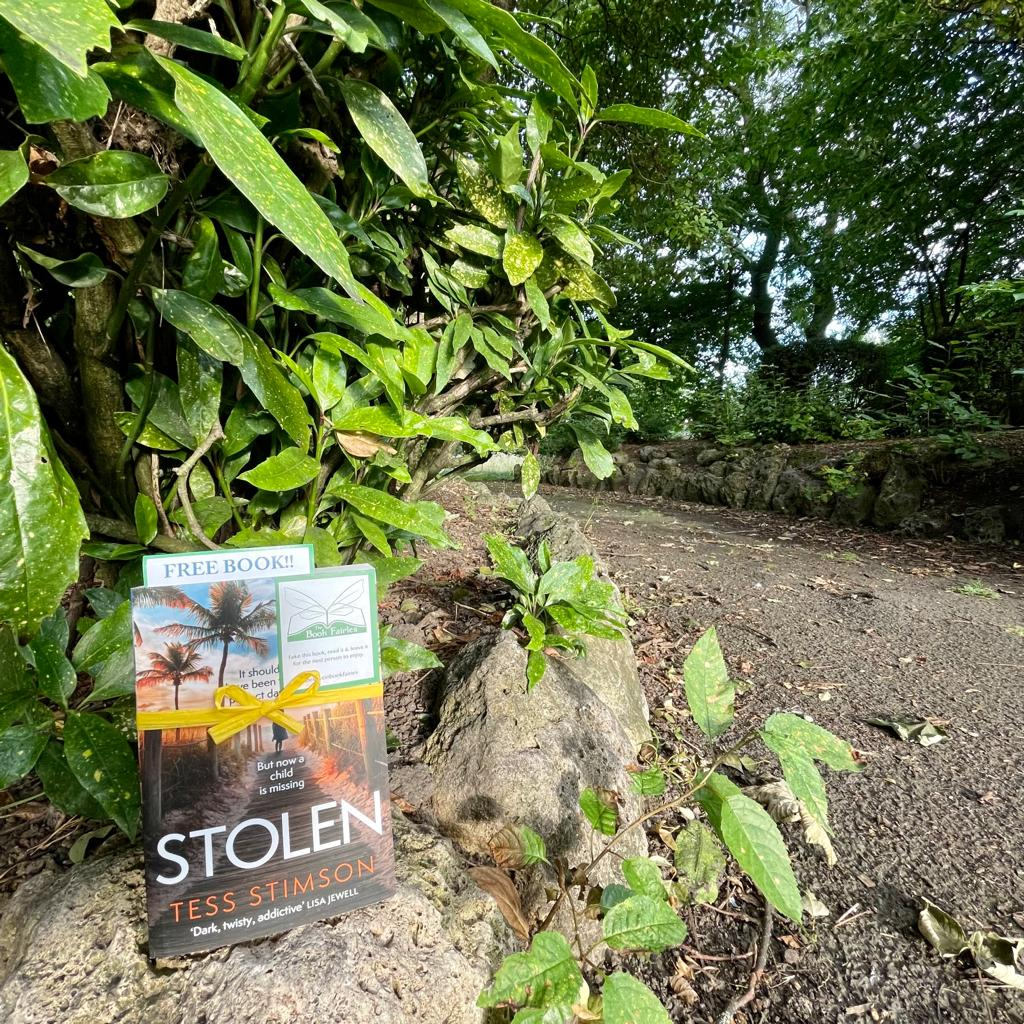 Book Fairies share copies of Stolen by Tess Stimson on a footpath