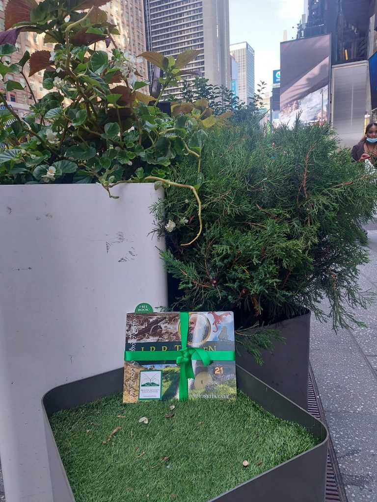 The Book Fairies share copies of J. R. R. Tolkien For Kids in Times Square NYC