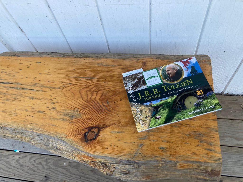 The Book Fairies share copies of J. R. R. Tolkien For Kids on a bench
