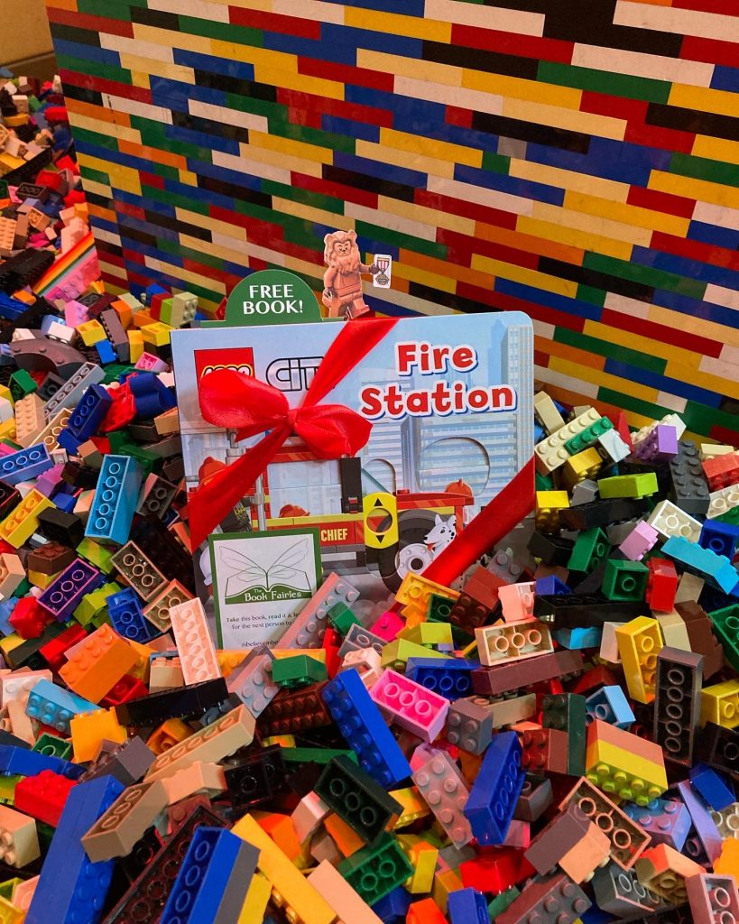 LEGOCity books hidden by book fairies at LEGO locations in a pile of LEGO