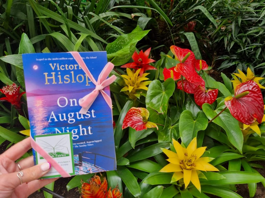 Book Fairies leave copies of One August Night by Victoria Hislop with flowers