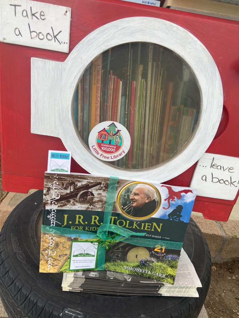 The Book Fairies share copies of J. R. R. Tolkien For Kids at a little free library