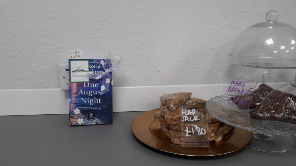 Book Fairies leave copies of One August Night by Victoria Hislop in a cafe