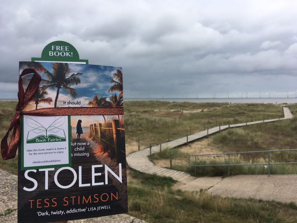 Book Fairies share copies of Stolen by Tess Stimson near the sea