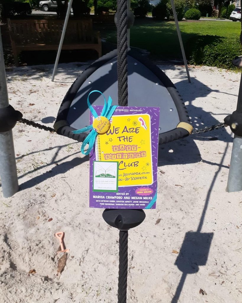 Book Fairies in the US share copies of We Are The Babysitter's Club on the swings