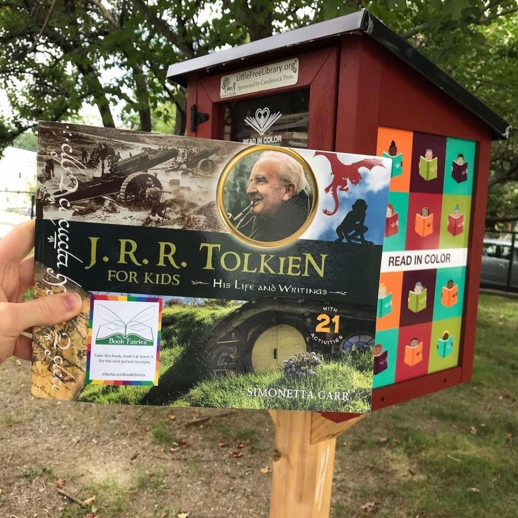 The Book Fairies share copies of J. R. R. Tolkien For Kids at a book swap
