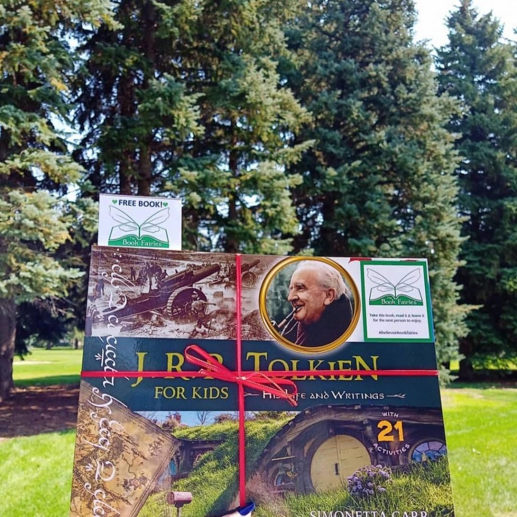 The Book Fairies share copies of J. R. R. Tolkien For Kids in woodland