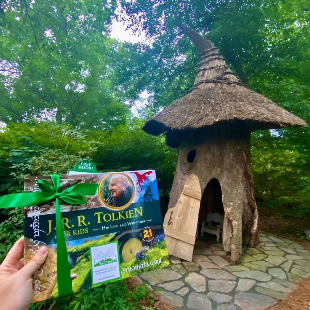 The Book Fairies share copies of J. R. R. Tolkien For Kids at a hobbit hole