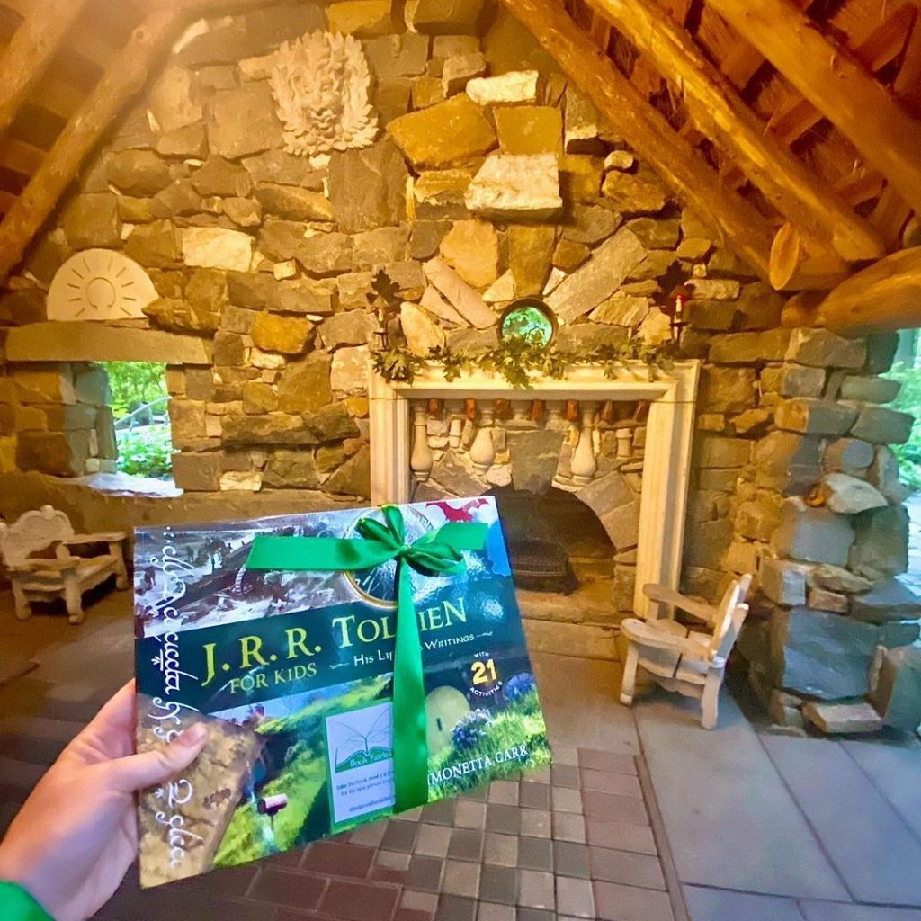 The Book Fairies share copies of J. R. R. Tolkien For Kids in a hobbit house