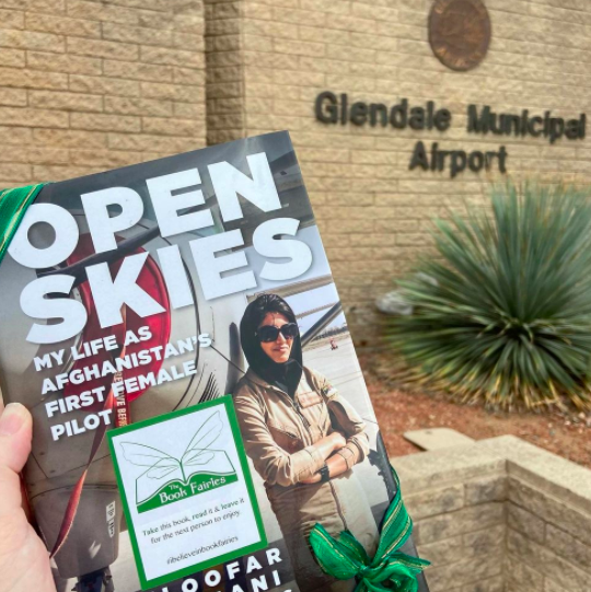 Open Skies by Niloofar Rahmani is hidden by book fairies at Glendale Municipal Airport