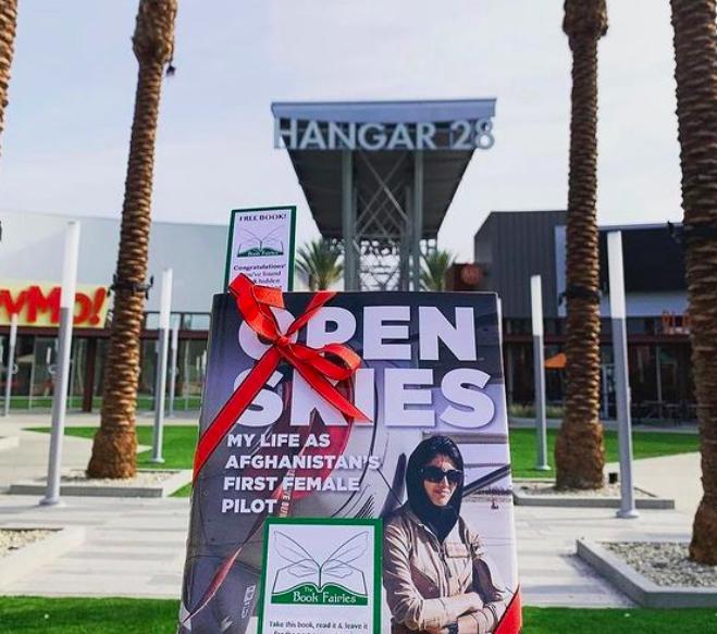 Open Skies by Niloofar Rahmani is hidden by book fairies at Hangar 28