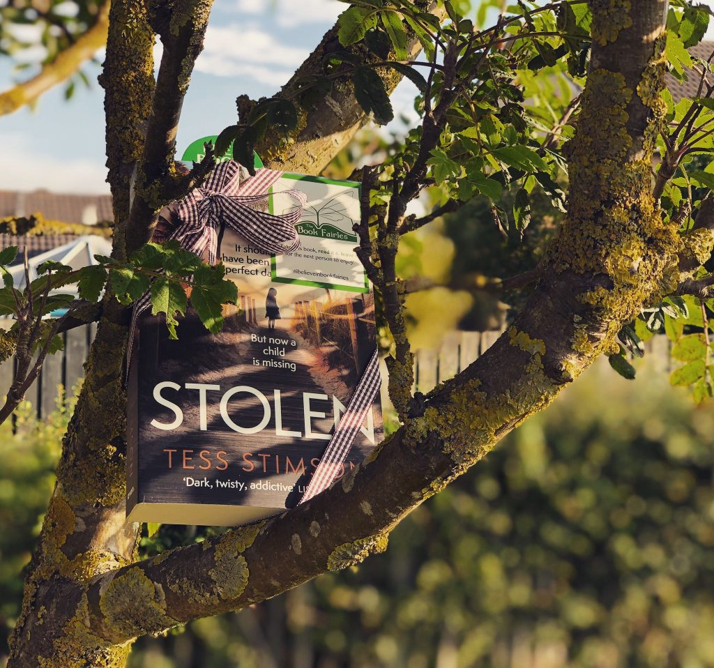 Book Fairies share copies of Stolen by Tess Stimson in a tree