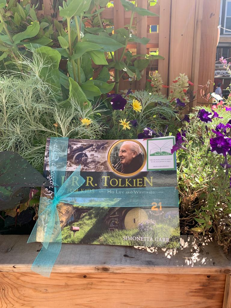 The Book Fairies share copies of J. R. R. Tolkien For Kids with flowers