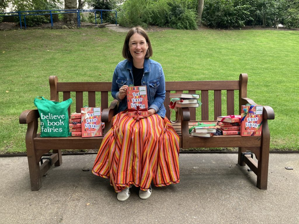 Author Freya Sampson becomes Book Fairy for a Day with The Last Library -posing with books