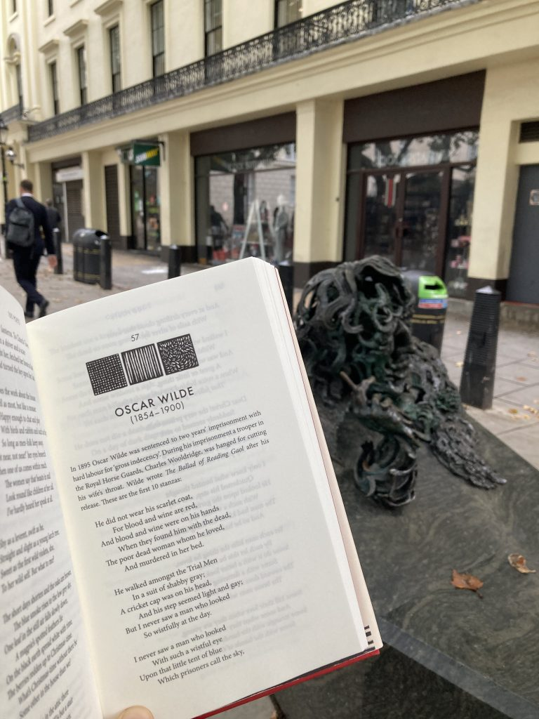 Book Fairies hide 100 Poets by John Carey at Oscar Wilde statue