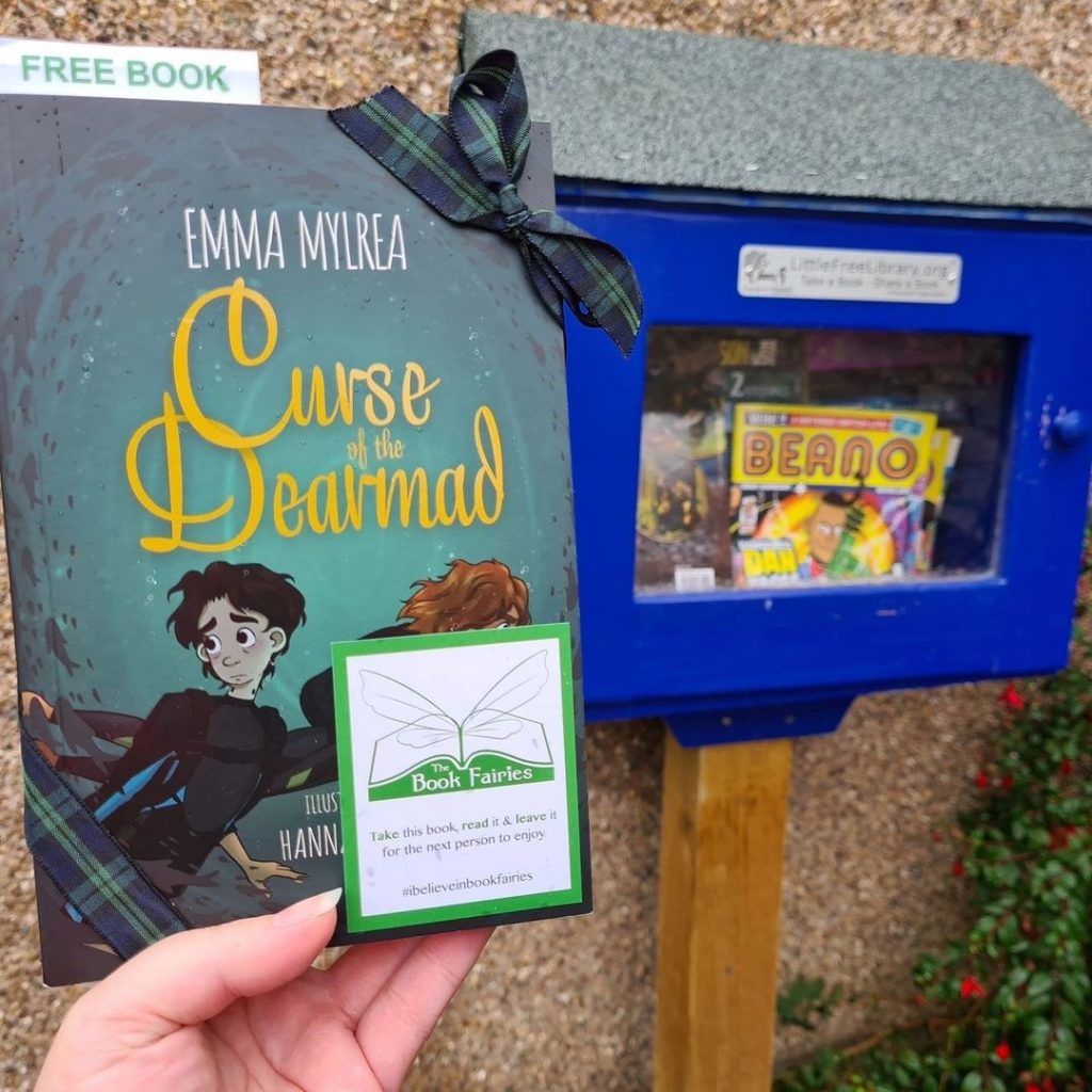 Curse of the Dearmad by debut author Emma Mylrea is shared by The Book Fairies at a little free library