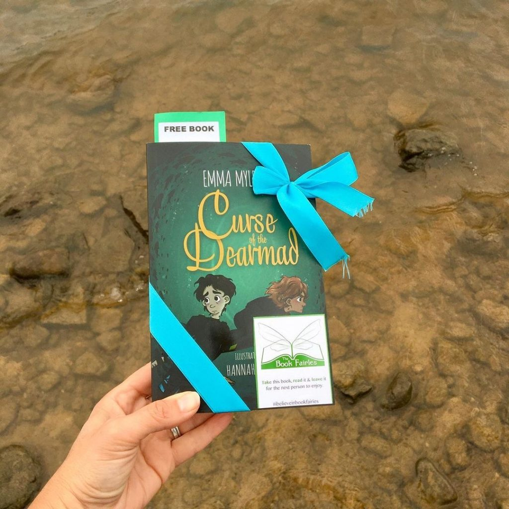 Curse of the Dearmad by debut author Emma Mylrea is shared by The Book Fairies at the seaside