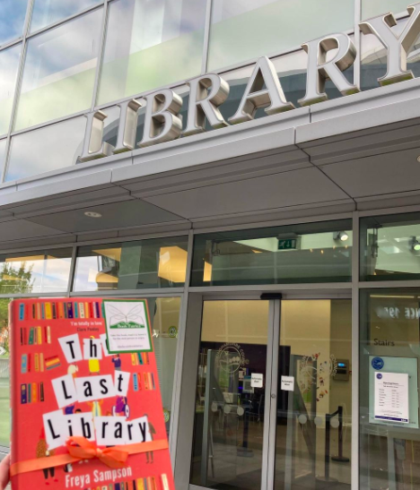 Book Fairies hide copies of The Last Library by Freya Sampson at a library