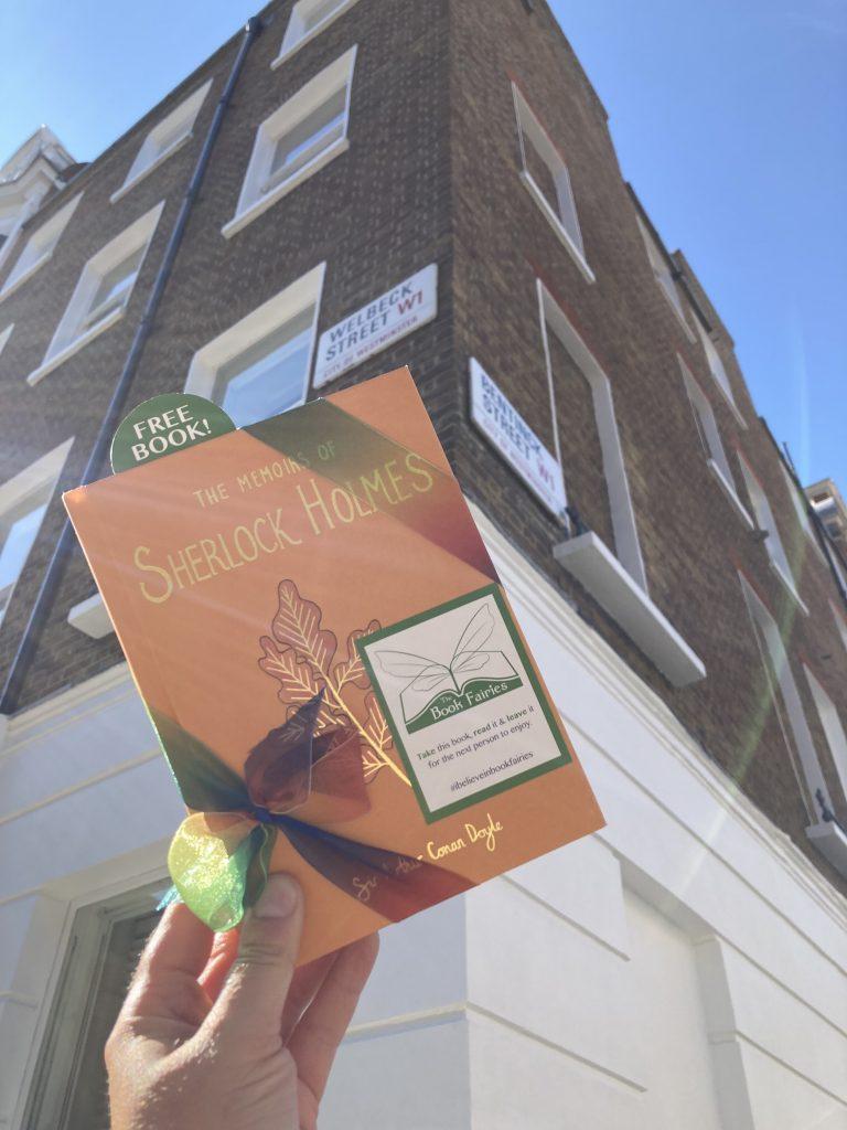 Sherlock Holmes from Wordsworth hidden by book fairies - London book fairies