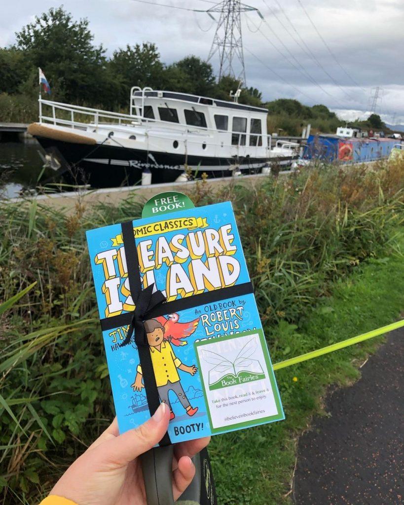 Treasure Island Comic Classics hidden by book fairies by a boat