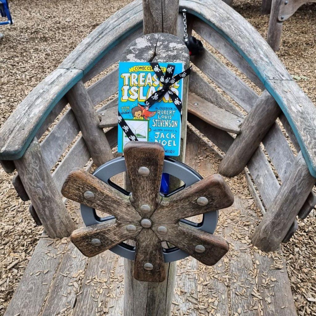 Treasure Island Comic Classics hidden by book fairies at a playground