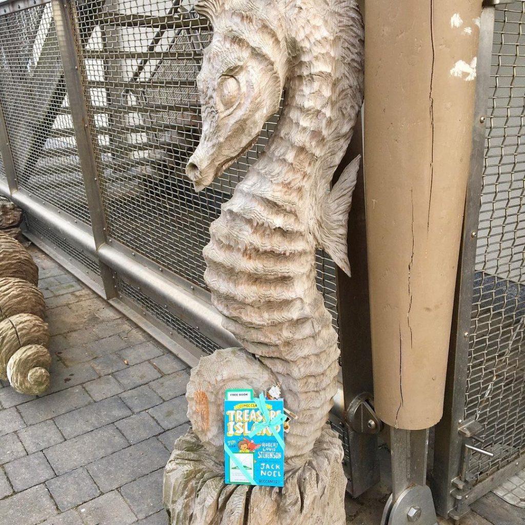 Treasure Island Comic Classics hidden by book fairies at a seahorse sculpture